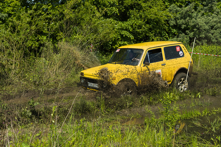 Lviv, Ukraine - May 30, 2015: Off-road vehicle VAZ-NIVA (No. 110) overcomes the track on  of   landfill near the city  Lviv.
