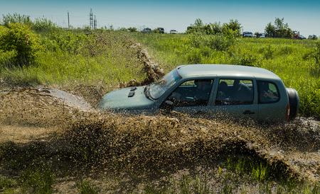 Lviv, Ukraine - May 30, 2015: Off-road vehicle NIVA  overcomes the track on  of   landfill near the city  Lviv.