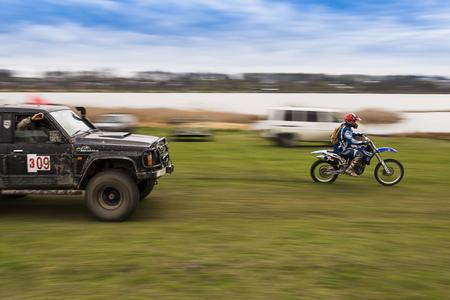 Lviv, Ukraine - April 18, 2015:Rider ahead of the crew SUV during overcome route around Lviv.Ukraine Editorial