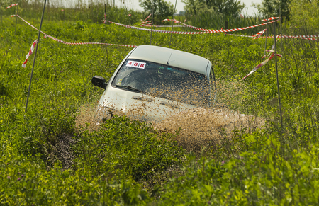 Lviv, Ukraine - May 30, 2015: Off-road vehicle NIVA- Chevrolet (No. 488) overcomes the track on of landfill near the city Lviv.