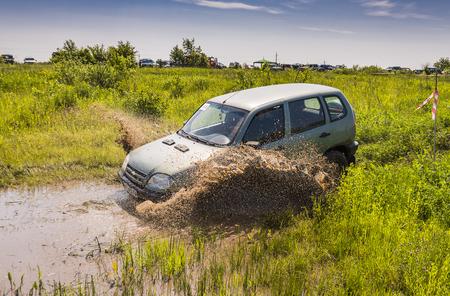 Lviv, Ukraine - May 30, 2015: Off-road vehicle NIVA-chevrolet  overcomes the track on of landfill near the city Lviv.