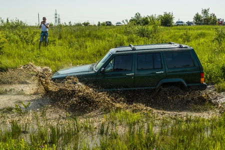 Lviv, Ukraine - May 30, 2015: Off-road vehicle Jeep Cherokee  overcomes the track on  of   landfill near the city  Lviv. Editorial