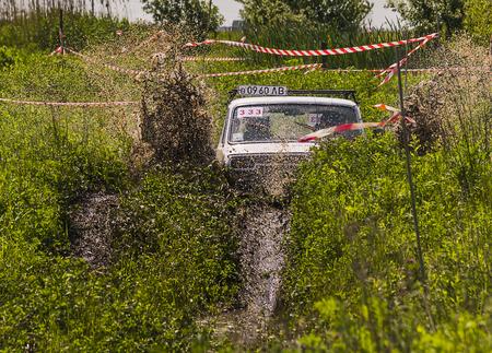 Lviv, Ukraine - May 30, 2015: Off-road vehicle VAZ-NIVA (No. 333) overcomes the track on of landfill near the city Lviv. Editorial