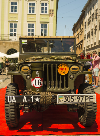 Lviv, Ukraine -- June 12, 2015: The restored car JEEP WILLYS (Millitary Police) is demonstrated by Leopolis Grand Com at Market Square in Lviv, Ukraine