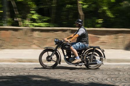 Lviv, Ukraine - June 13, 2015:Old retro motorcycle  IZ - 49 taking  participation in race Leopolis grand prix 2015, Ukraine.