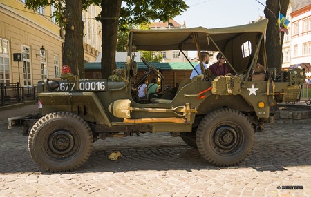 Lviv, Ukraine -- June 12, 2015: The restored car JEEP WILLYS (Military Police) is demonstrated by Leopolis Grand Com at Market Square in Lviv, Ukraine Editorial