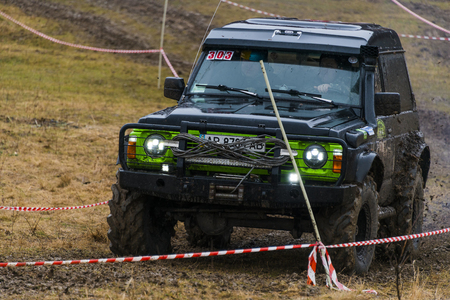 rival: Lviv, Ukraine - February 21, 2016: Off-road vehicle brand Nissan (No. 303) overcomes the track on a amateur competitions Trial near the city Lviv, Ukraine Editorial