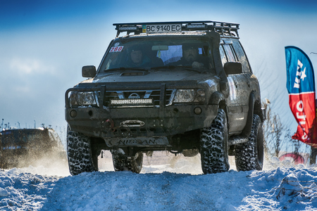 rival: Lviv, Ukraine - December 04, 2016: Off-road vehicle brand Nissan overcomes the track on a amateur competitions Trial near the city Lviv, Ukraine