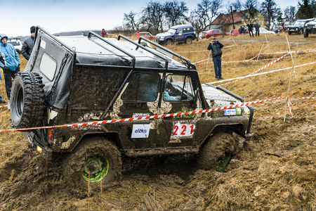 Lviv, Ukraine - February 21, 2016: Off-road vehicle UAZ (No. 221) overcomes the track on of landfill near the city Lviv.
