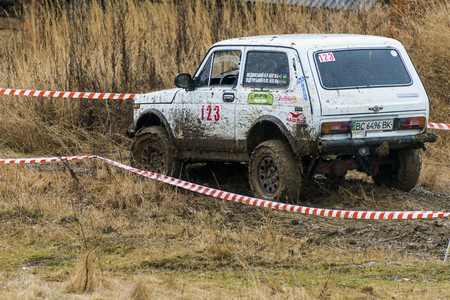 Lviv, Ukraine - February 21, 2016: Off-road vehicle brand VAZ - NIVA (No. 123) overcomes the track on a amateur competitions Trial near the city Lviv, Ukraine Editorial
