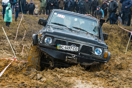 Lviv, Ukraine - February 21, 2016: Off-road vehicle brand Nissan (No. 277) overcomes the track on a amateur competitions Trial near the city Lviv, Ukraine Editorial