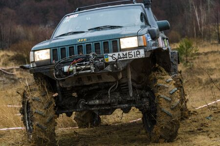 Lviv, Ukraine - February 21, 2016: Off-road vehicle brand Jeep Cherokee overcomes the track on a amateur competitions Trial near the city Lviv, Ukraine Editorial