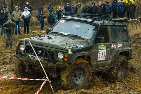 Lviv, Ukraine - February 21, 2016: Off-road vehicle brand Nissan (No. 312) overcomes the track on a amateur competitions Trial near the city Lviv, Ukraine
