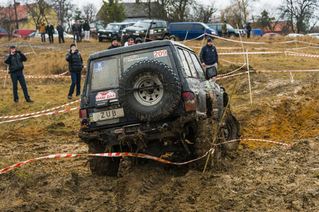 Lviv, Ukraine - February 21, 2016: Off-road vehicle brand Nissan (No. 209) overcomes the track on at amateur competitions Trial near the city Lviv, Ukraine