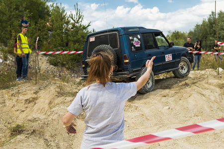 rival: Lviv, Ukraine - August 23, 2015: Navigator shows the way when the driver of vehicle overcomes the track on of sandy career near the city Lviv, Ukraine.