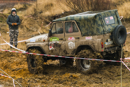 Lviv, Ukraine - February 21, 2016: Off-road vehicle brand UAZ  overcomes the track on a amateur competitions Trial near the city Lviv, Ukraine