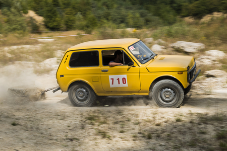 Lviv, Ukraine - August 23, 2015: Off-road vehicle brand VAZ- NIVA with burden overcomes the track on of sandy career near the city Lviv, Ukraine. Editorial