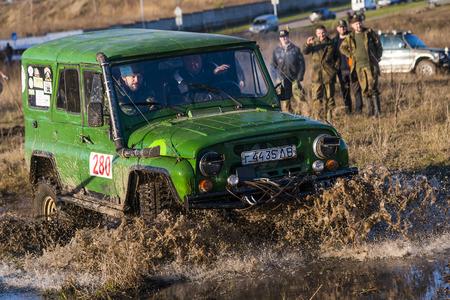 Lviv,Ukraine- December 6, 2015: Off-road vehicle brand UAZ overcomes the track on a polygon near the city Lviv, Ukraine