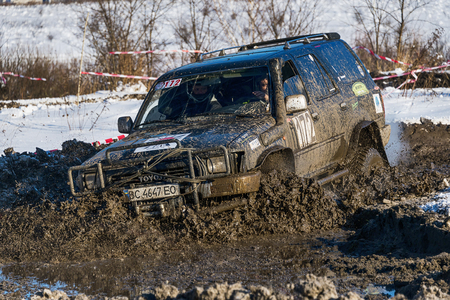 winter road: Lviv, Ukraine - December 04, 2016: Off-road vehicle brand Toyota overcomes the track on a amateur competitions Trial near the city Lviv, Ukraine