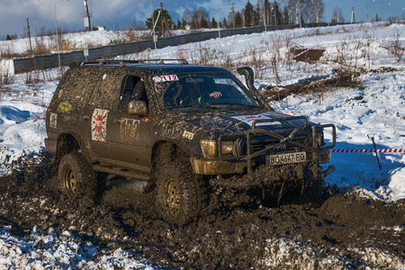 toyota: Lviv, Ukraine - December 04, 2016: Unknown racers  on off-road vehicle Toyota overcomes the track at amateur competitions among off-road vehicles near ringroad of  the city Lviv, Ukraine