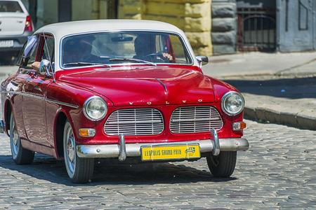 Lviv, Ukraine - June 4, 2017: Old retro car VOLVO AMAZON 121 with its owner and au unknown passengers taking participation in race Leopolis grand prix 2017, Ukraine.
