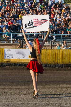 Rivne, Ukraine - 29 August 2015: Pit lane girl during competitions at  the Open Cup Speedway to the day of the city Rivne