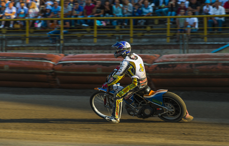 "Rivne, Ukraine - 29 August 2015: Unknown rider (â""– 5) overcomes the track at the Open Cup Speedway to the day of the city Rivne"