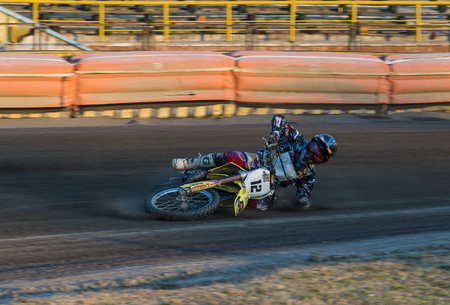 Rivne, Ukraine - 29 August 2015: Unknown rider falls at overcoming the track at the Open Cup Speedway to the day of the city Rivne Editorial