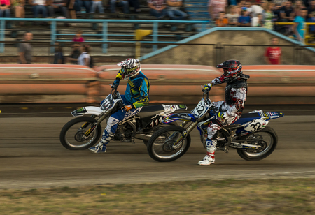 Rivne, Ukraine - 29 August 2015: Unknown riders overcomes the track at the Open Cup Speedway to the day of the city Rivne