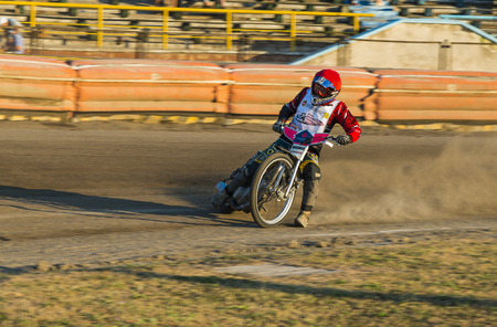 Rivne, Ukraine - 29 August 2015: Unknown rider prepares for the start at the Open Cup Speedway to the day of the city Rivne