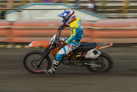 Rivne, Ukraine - 29 August 2015: Unknown rider overcomes the track at the Open Cup Speedway to the day of the city Rivne Editorial