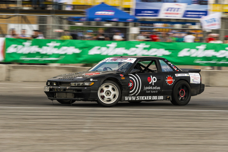 shiny car: Lviv, Ukraine - June 4, 2016: Unknown rider on the car brand Nissan overcomes the track in the championship of Ukraine drifting in Lviv, Ukraine.