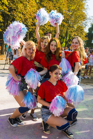 cheerleading squad: Lviv, Ukraine - August 30, 2015: Cheerleaders have fun during the festival of color in a city park in Lviv.