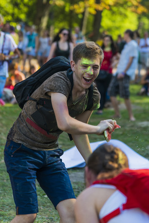 Lviv, Ukraine - August 30, 2015: Man  have fun during the festival watermelon  in a city park in Lviv. Editorial