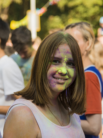 Lviv, Ukraine - August 30, 2015: Girl have fun during the festival of color in a city park in Lviv. Editorial