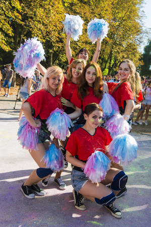 Lviv, Ukraine - August 30, 2015: Cheerleaders have fun during the festival of color in a city park in Lviv.