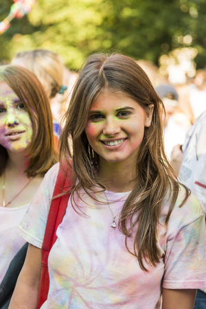 Lviv, Ukraine - August 30, 2015: Girls  have fun during the festival of color in a city park in Lviv.