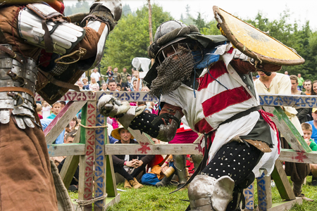Urych, Ukraine - August 6,2016: Tustan Medieval Culture Festival in Urych, Western Ukraine, on August 6, 2016.Participants of the festival in knight armor arrange fights