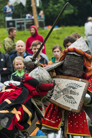 iron man: Urych, Ukraine - August 6,2016: Tustan Medieval Culture Festival in Urych, Western Ukraine, on August 6, 2016.Participants of the festival in knight armor arrange fights