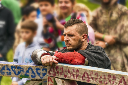 Urych, Ukraine - August 6,2016: Tustan Medieval Culture Festival in Urych, Western Ukraine, on August 6, 2016.Participant reconstruction watching fight. Editorial