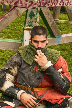Urych, Ukraine - August 6,2016: Tustan Medieval Culture Festival in Urych, Western Ukraine, on August 6, 2016 . Participant of the festival in knight armor after  fights.