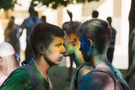 Lviv, Ukraine - August 28, 2016: Girl having fun during the festival of color in a city park in Lviv.