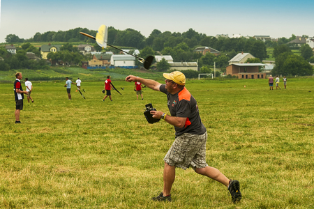Lviv, Ukraine - July 23, 2017: Unknown aircraft modeler launches his own radio-controlled  model  glider  in the countryside near the city of Lviv., Ukraine.