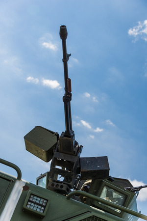 Heavy machine gun mounted on the armored vehicle