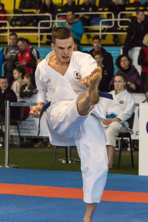 Lviv , Ukraine - March 25, 2018: International open karate cup . Unknown athlete performs during the competition  in the sports complex of the army,  Lviv, Ukraine. Editorial