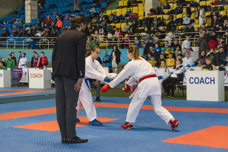 Lviv , Ukraine - March 25, 2018: International open karate cup . Unknown judge watch the duel of athletes during the competition  in the sports complex of the army,  Lviv, Ukraine.