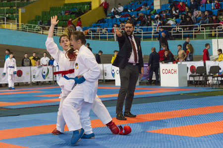 Lviv , Ukraine - March 25, 2018: International open karate cup . The referee stops the fight competitors in the sports complex of the army,  Lviv, Ukraine.