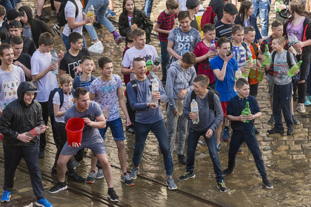 Lviv , Ukraine - April 09 2018:  Ð¡elebrations  Wet Monday, a Ukrainian Christian tradition celebrated on the first day after Orthodox Easter. Young people prepared for pouring water near the town hall. Lviv, Ukraine. Редакционное