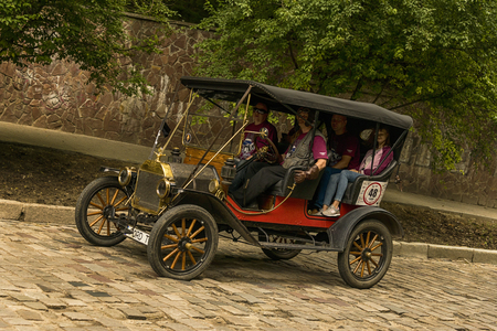 Lviv, Ukraine - June 3, 2018:Old retro car Ford T its owner and an unknown passenger taking participation in race Leopolis grand prix 2018, Ukraine. Sajtókép