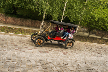 Lviv, Ukraine - June 3, 2018:Old retro car Ford T its owner and an unknown passenger taking participation in race Leopolis grand prix 2018, Ukraine. Editorial
